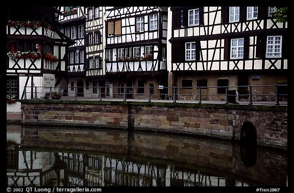 Half-timbered houses reflected in canal. Strasbourg, Alsace, France