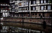 Half-timbered houses reflected in canal. Strasbourg, Alsace, France (color)