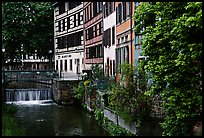 Half-timbered houses next to a canal. Strasbourg, Alsace, France