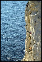 Rock climbing above water in the Calanque de Morgiou. Marseille, France (color)