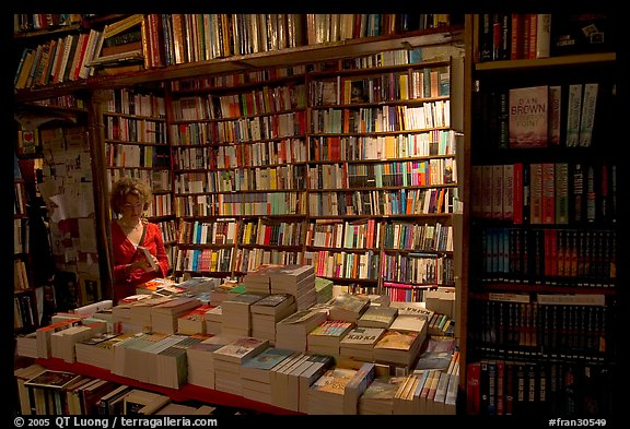 Checking a book in Shakespeare and Company bookstore. Quartier Latin, Paris, France (color)