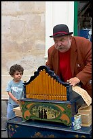 Barrel organ player and kid. Quartier Latin, Paris, France