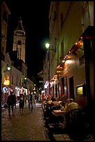 Dinners and narrow pedestrian street at night, Montmartre. Paris, France ( color)
