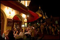 Outdoor restaurant at night on the Place du Tertre, Montmartre. Paris, France