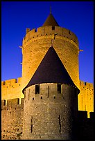 Towers with witch hat roofs by night. Carcassonne, France