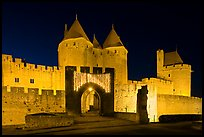 Medieval city and main entrance by night. Carcassonne, France