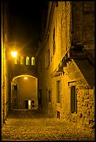 Cobblestone street by night inside medieval city. Carcassonne, France