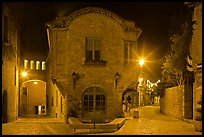 Stone buildings and streets at night. Carcassonne, France