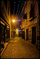 Medieval street by night with Christmas decorations and. Carcassonne, France