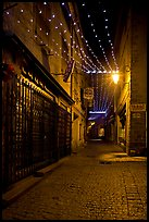 Lonely street by night with Tabac sign and Christmas lights. Carcassonne, France