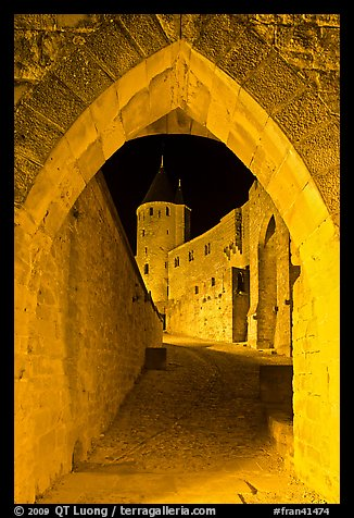 Ramparts and tower framed by gate at night. Carcassonne, France (color)
