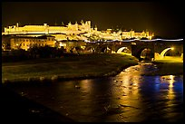 Fortified city and Pont Vieux crossing the Aude River by night. Carcassonne, France (color)