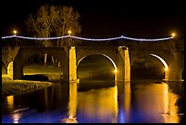 Pont Vieux illuminated by night with Christmas lights. Carcassonne, France ( color)