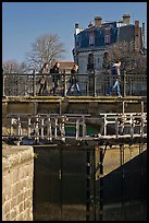 Pedestrians walking on brige above Canal du Midi. Carcassonne, France