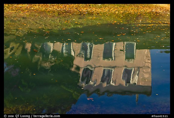 House reflections with fallen leaves, Canal du Midi. Carcassonne, France (color)