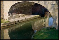 Stone bridge across Canal du Midi. Carcassonne, France