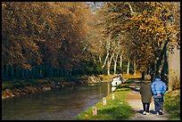 Couple walking along Canal du Midi. Carcassonne, France
