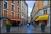 Pedestrian street with couple pushing stroller. Grenoble, France