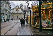 Street carousel and church. Grenoble, France