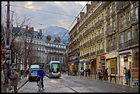 Bicyclist and tramway next to Victor Hugo place. Grenoble, France