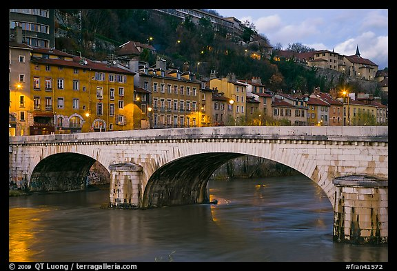 Bridge and brightly painted riverside houses at dusk. Grenoble, France (color)