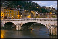 Bridge and brightly painted riverside houses at dusk. Grenoble, France ( color)