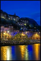 Hillside houses and Christmas lights reflected in Isere River. Grenoble, France ( color)
