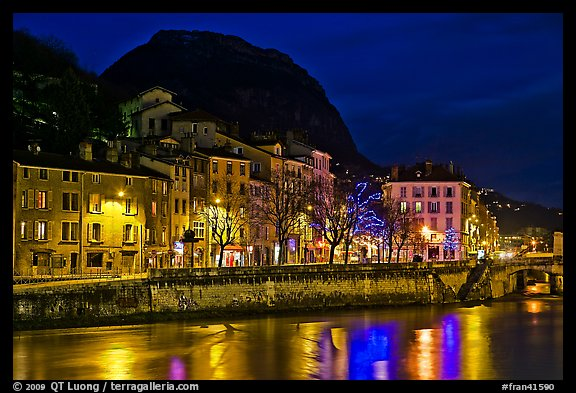 Isere River and houses below the Citadelle at night. Grenoble, France (color)