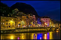 Isere River and houses below the Citadelle at night. Grenoble, France