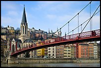 Suspension brige on the Saone River and St-George church. Lyon, France