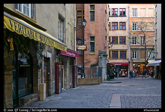 Square with restaurant offering the local specialty bouchon lyonnais. Lyon, France (color)