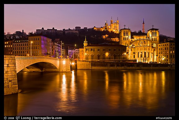 Napoleon Bridge, Saone River and Fourviere Hill at night. Lyon, France