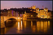 Napoleon Bridge, Saone River and Fourviere Hill at night. Lyon, France (color)