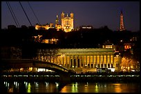 Passerelle, Palais de Justice, and Basilique Notre Dame de Fourviere by night. Lyon, France