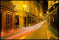 Street with light trails left by cars. Lyon, France (color)