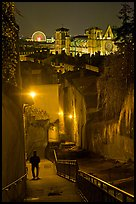 Man walking down stairs from Fourviere Hill, with St-Jean Cathedral below. Lyon, France