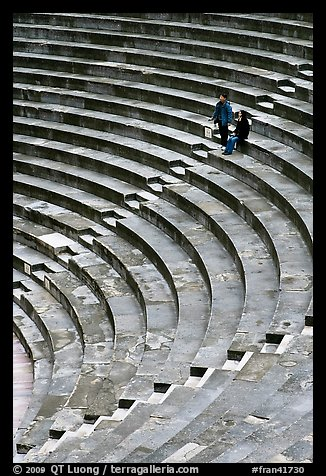 Couple standing in amphitheater, Orange. Provence, France (color)