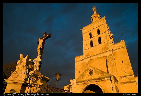 Crucifix and romanesque tower of Notre-Dame-des-Doms Cathedral. Avignon, Provence, France (color)