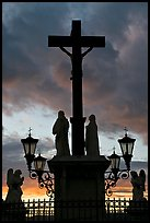 Cross and statues with sunset clouds. Avignon, Provence, France