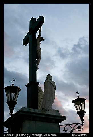 Cross with Christ at sunset. Avignon, Provence, France (color)