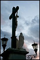 Cross with Christ at sunset. Avignon, Provence, France ( color)