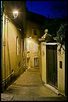Narrow cobblestone street and street light. Avignon, Provence, France