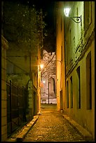 Narrow street leading to Palais des Papes at night. Avignon, Provence, France ( color)