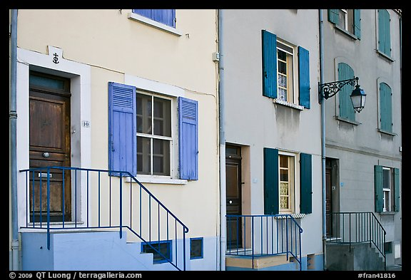 Facade of townhouses with colorful shutters. Arles, Provence, France (color)