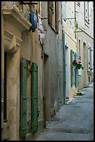 Painted facades in narrow street. Arles, Provence, France (color)