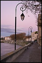 Walkway on the banks of the Rhone River at dusk. Arles, Provence, France (color)
