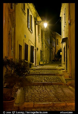 Cobblestone passageway with stepts at night. Arles, Provence, France (color)