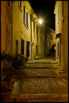 Cobblestone passageway with stepts at night. Arles, Provence, France ( color)