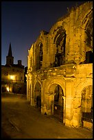 Roman arenes and church at night. Arles, Provence, France