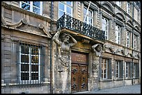 Facade with sculptures supporting a balcony. Aix-en-Provence, France ( color)